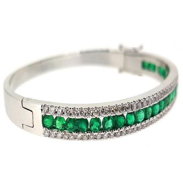 18 carats white gold bangle with Colombian emeralds and channel set diamonds from Madaame